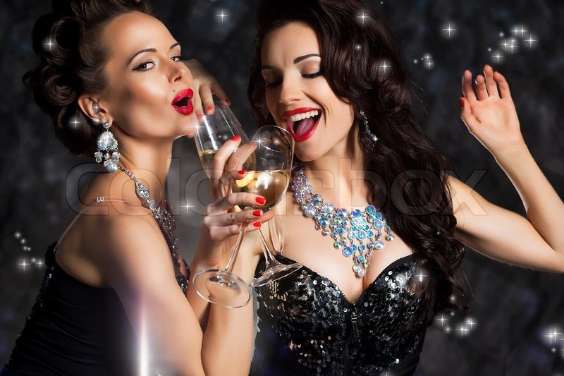 5477691-happy-laughing-women-drinking-champagne-and-singing-xmas-song