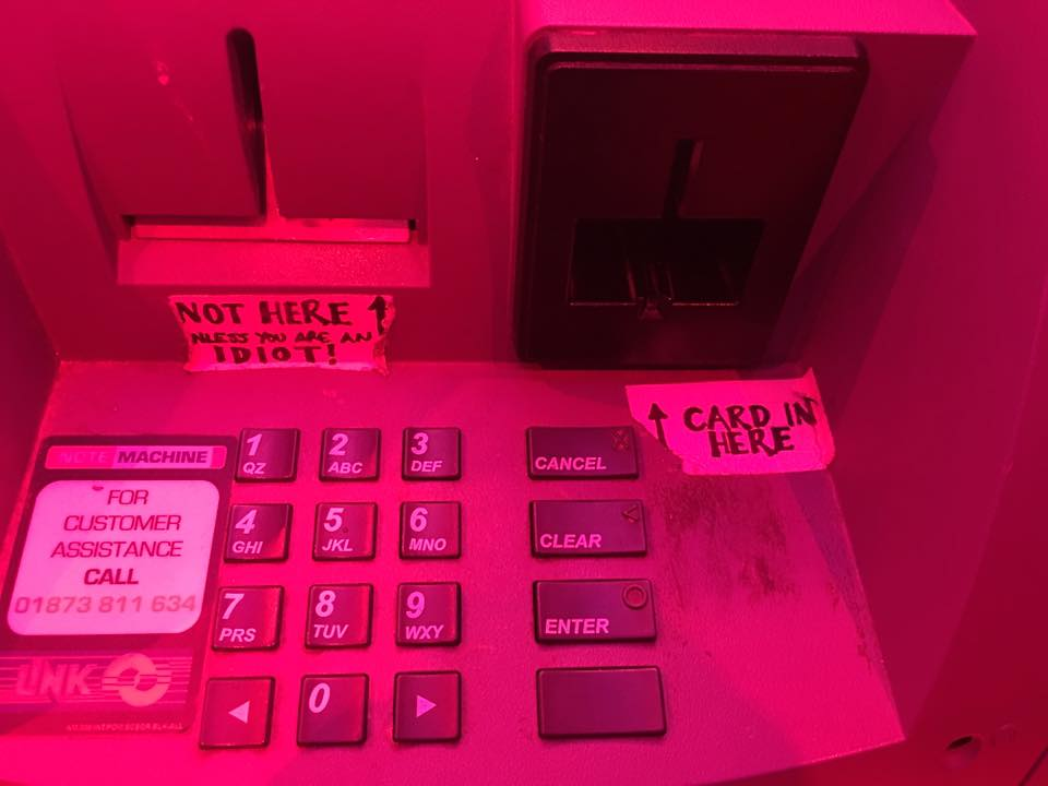Sign on ATM at Dive Bar